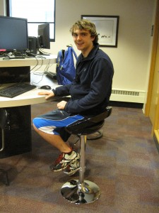 Student Joe Boino tests out one of the new computer stools on the Library's second floor.